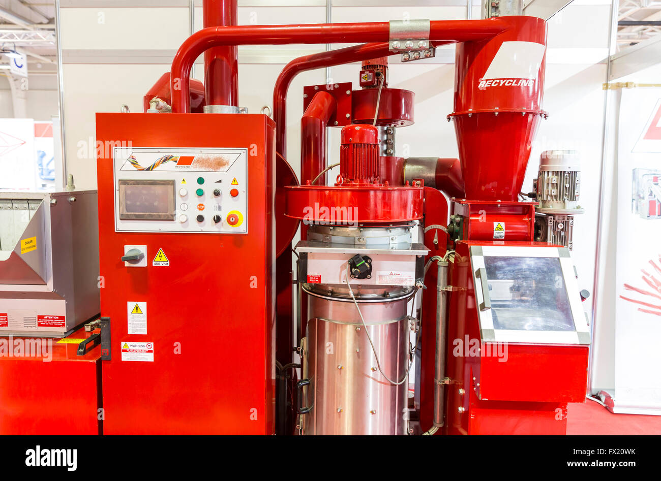 Red recycling machine. Recycles plastic and glass bottles. Control panel with computer monitor and different buttons. - Stock Image