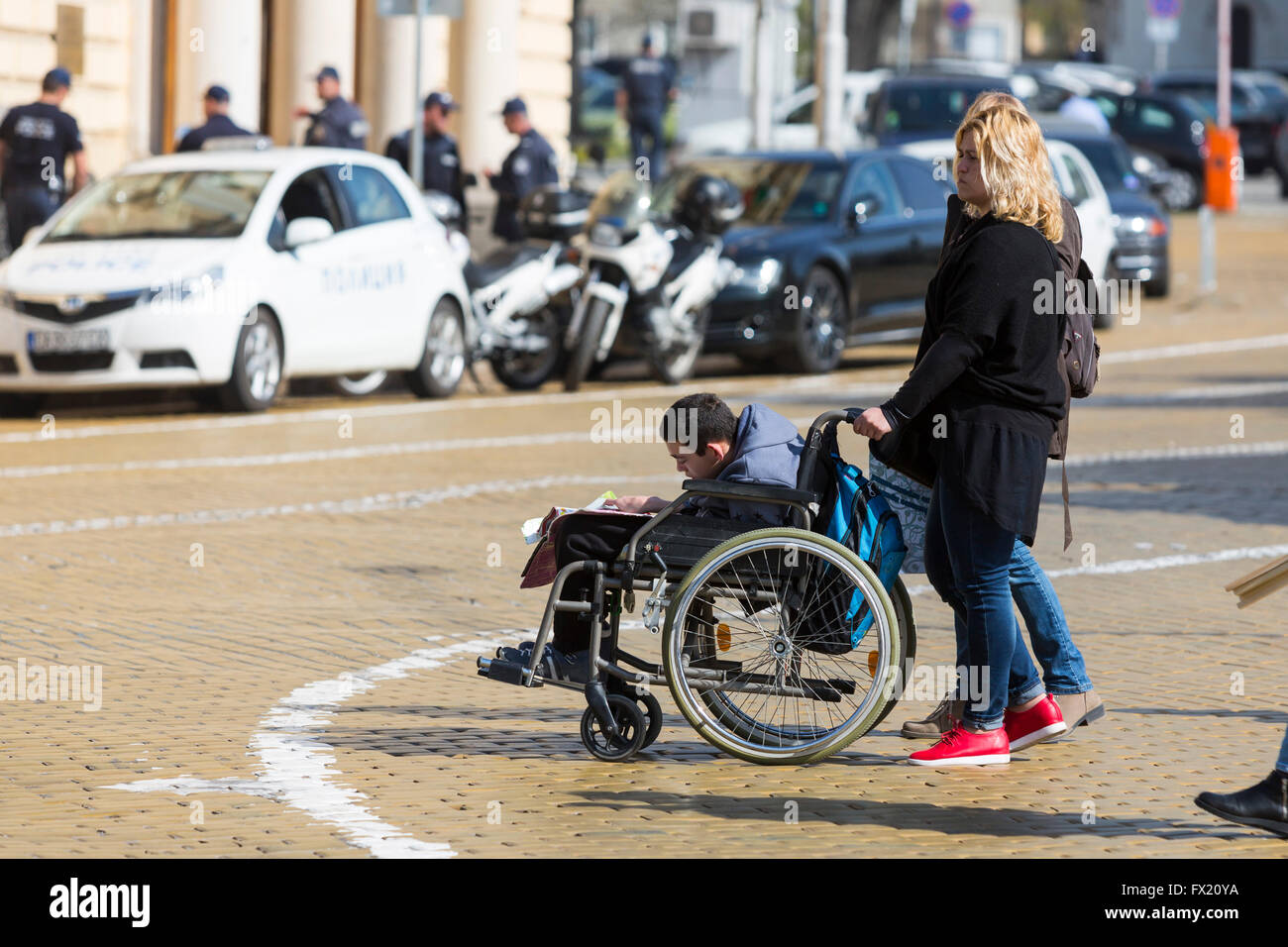 Sofia, Bulgaria - April 6, 2016: Physically and mentally disabled are accompanied by their parents, relatives and - Stock Image
