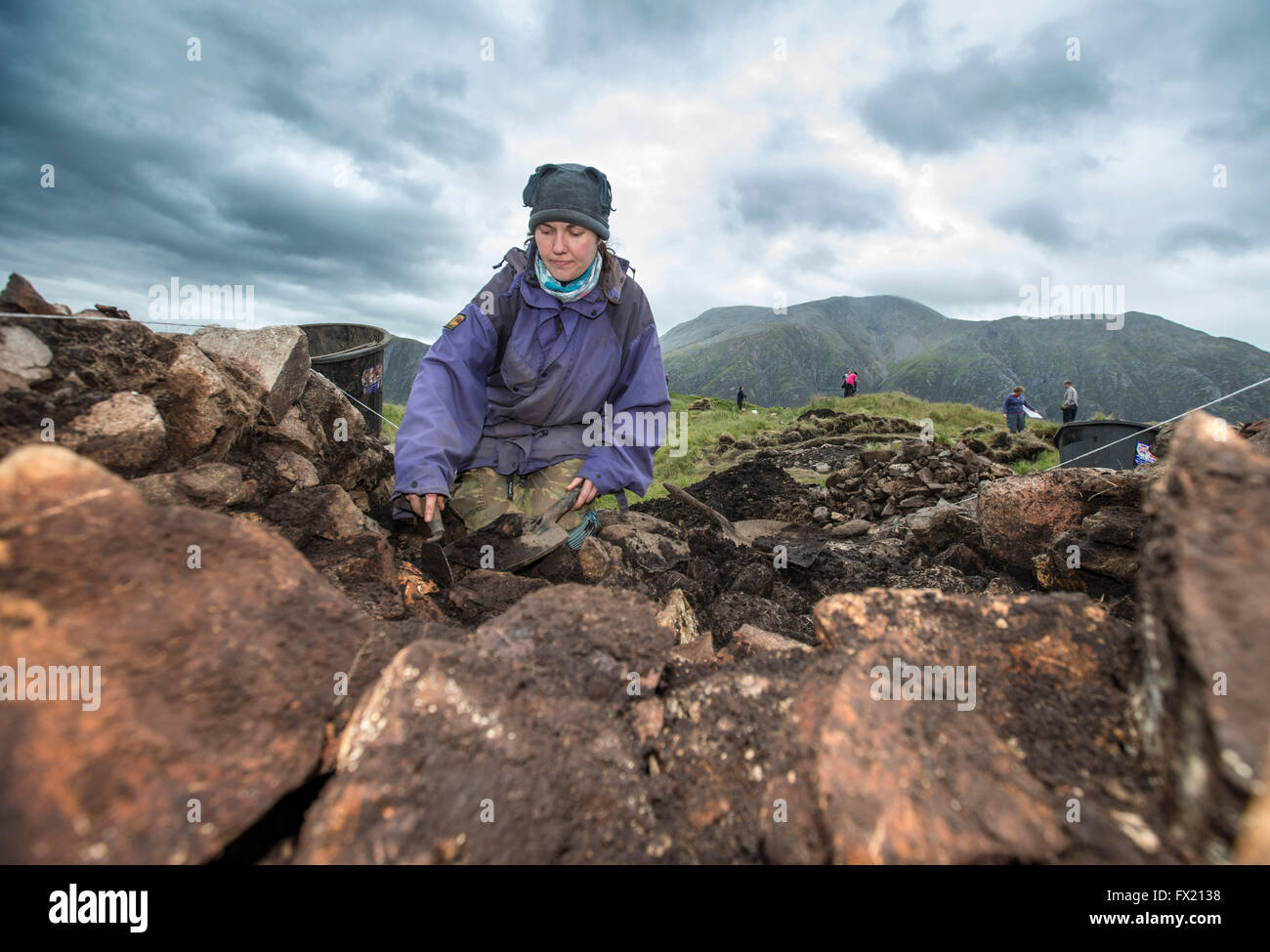 Archaeological Dig on Dun Deardail.with Ben Nevis in background - Stock Image