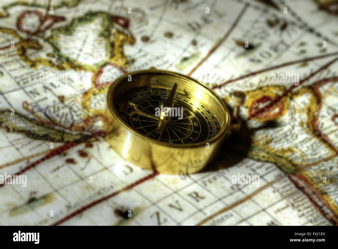 Antique brass compass on map - Stock Image