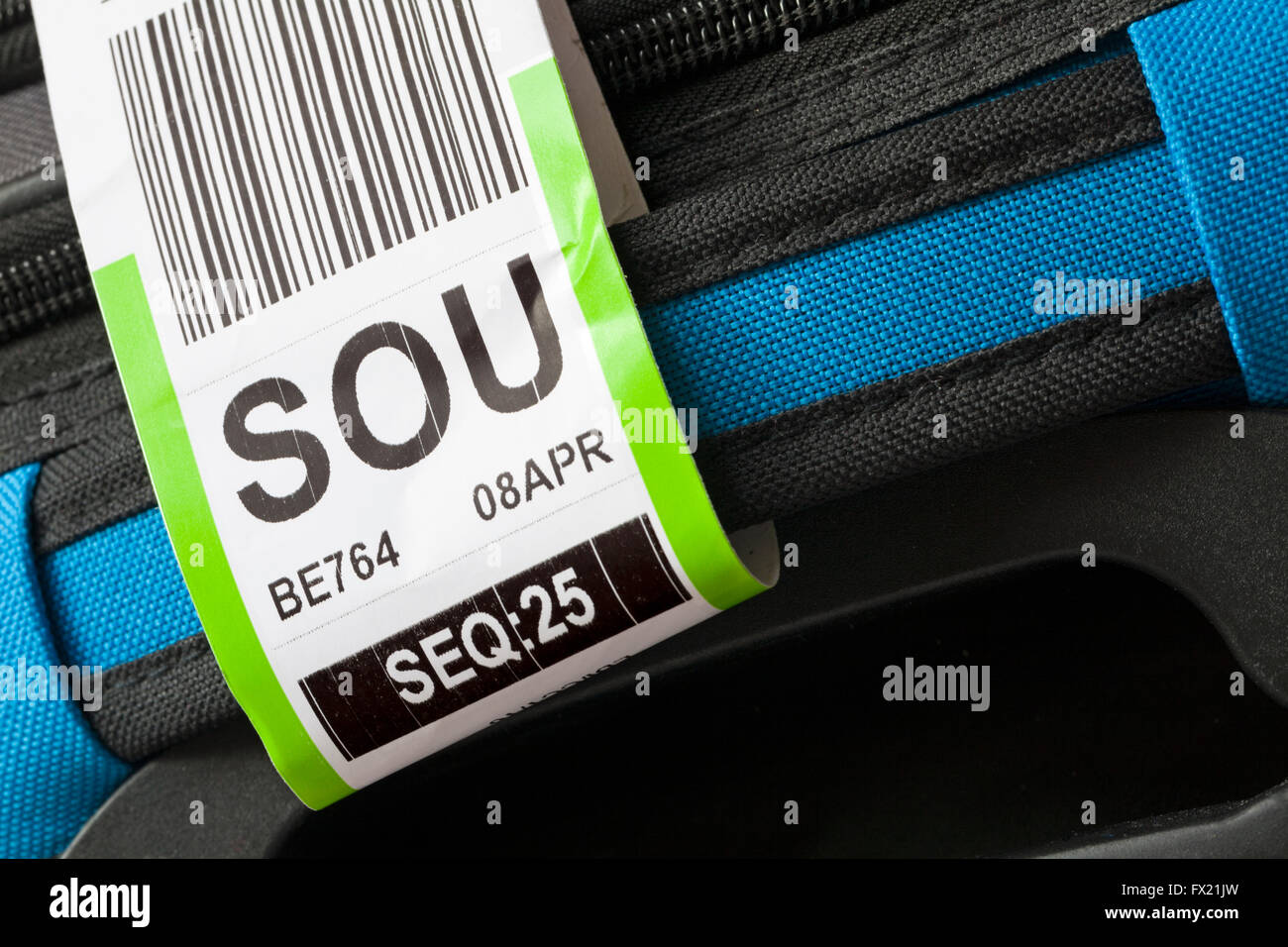 luggage label stuck on case for SOU Southampton airport - Stock Image