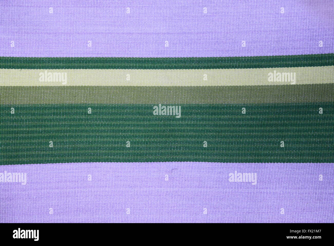 Lavender / purple, khaki and green horizontally striped woven fabric - Stock Image