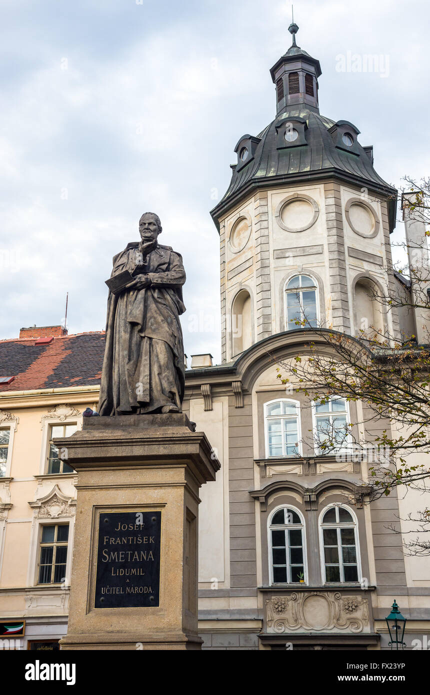 Josef Smetana statue and Former Premonstratensian College in Pilsen, Czech Republic. Study and Library of Pilsen - Stock Image