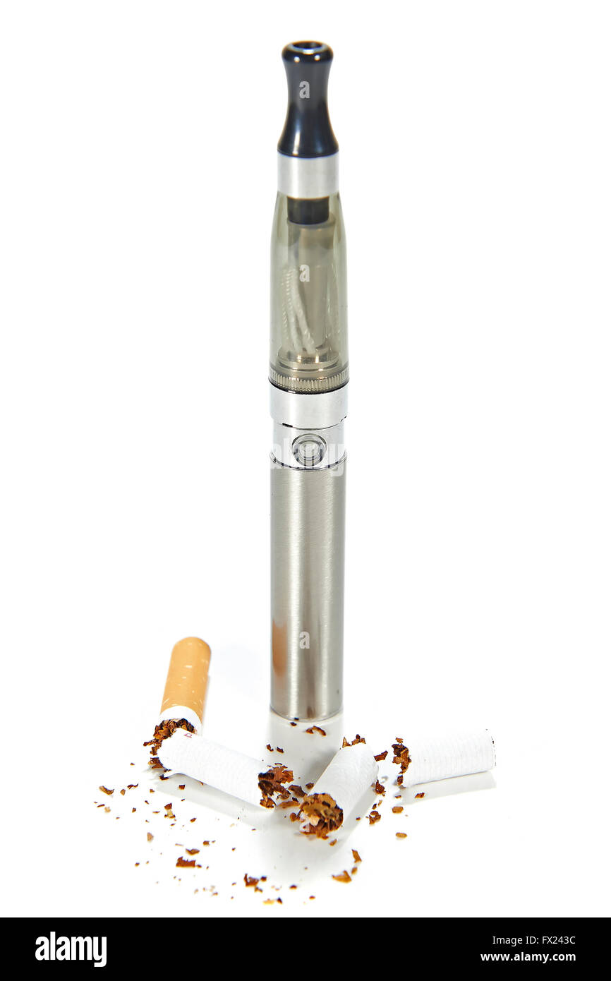 Electronic cigarette with broken real cigarettes around it - Stock Image