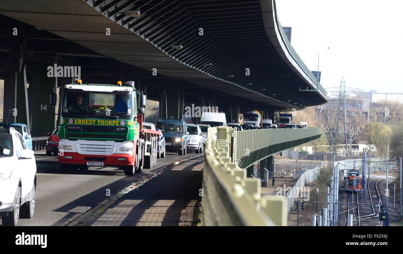 A flatbed lorry in queuing traffic on Tinsley Viaduct, Sheffield - Stock Image