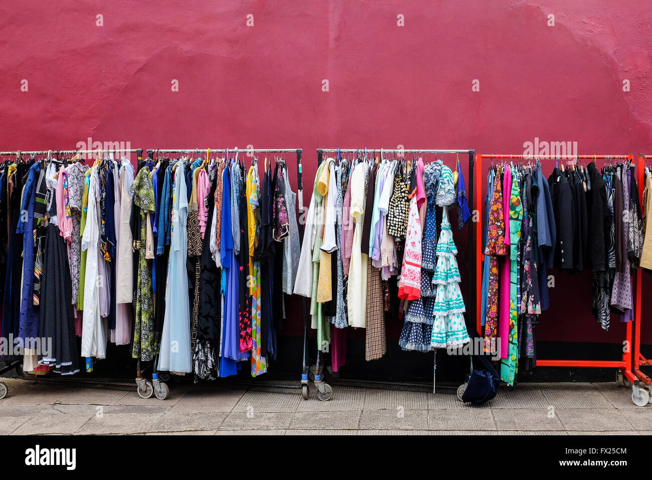 Rails of secondhand clothes for sale at Glasgow flea market, The Barras, Glasgow, Scotland, UK - Stock Image