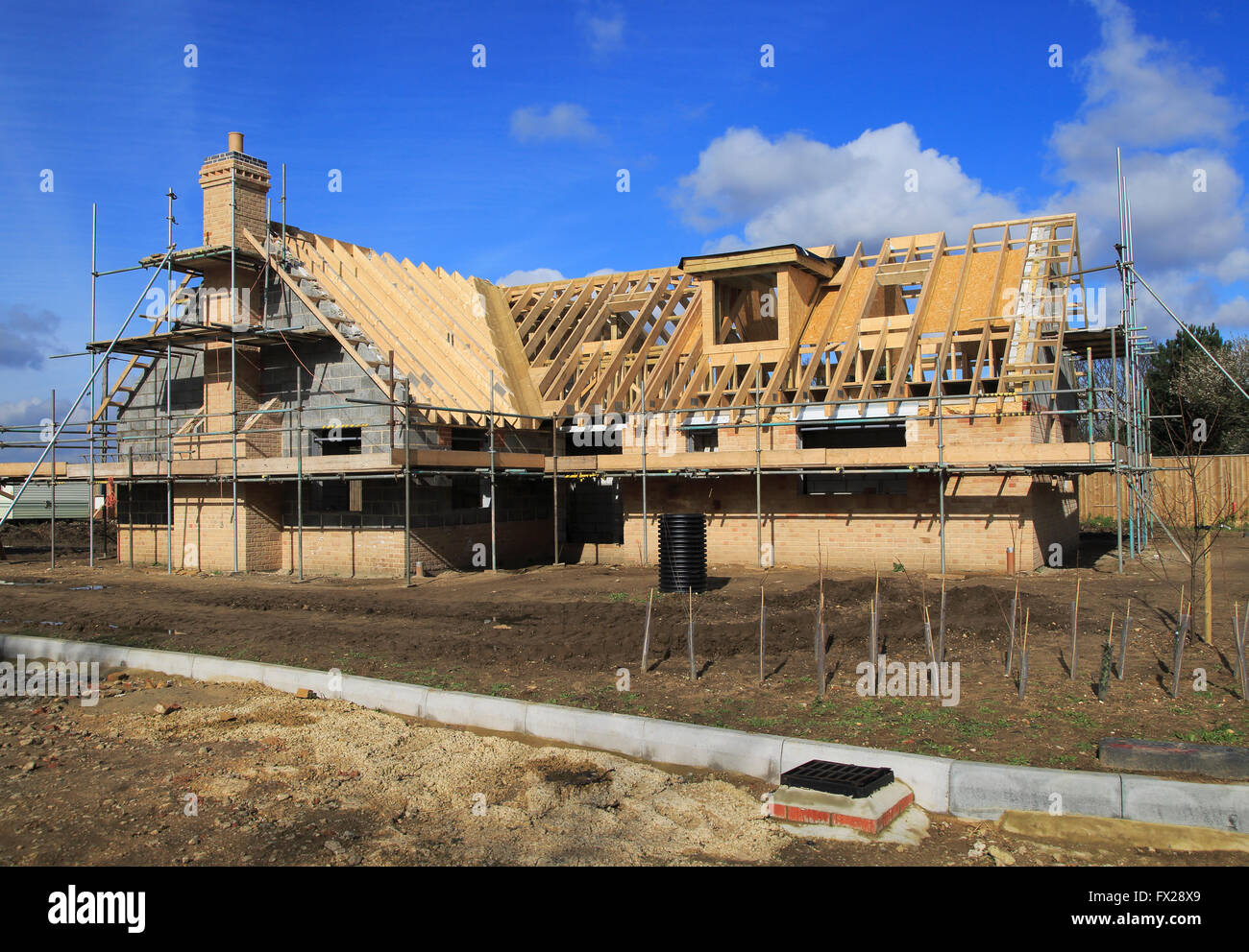 New detached house under construction, Hollesley, Suffolk,  Suffolk, England, UK Stock Photo