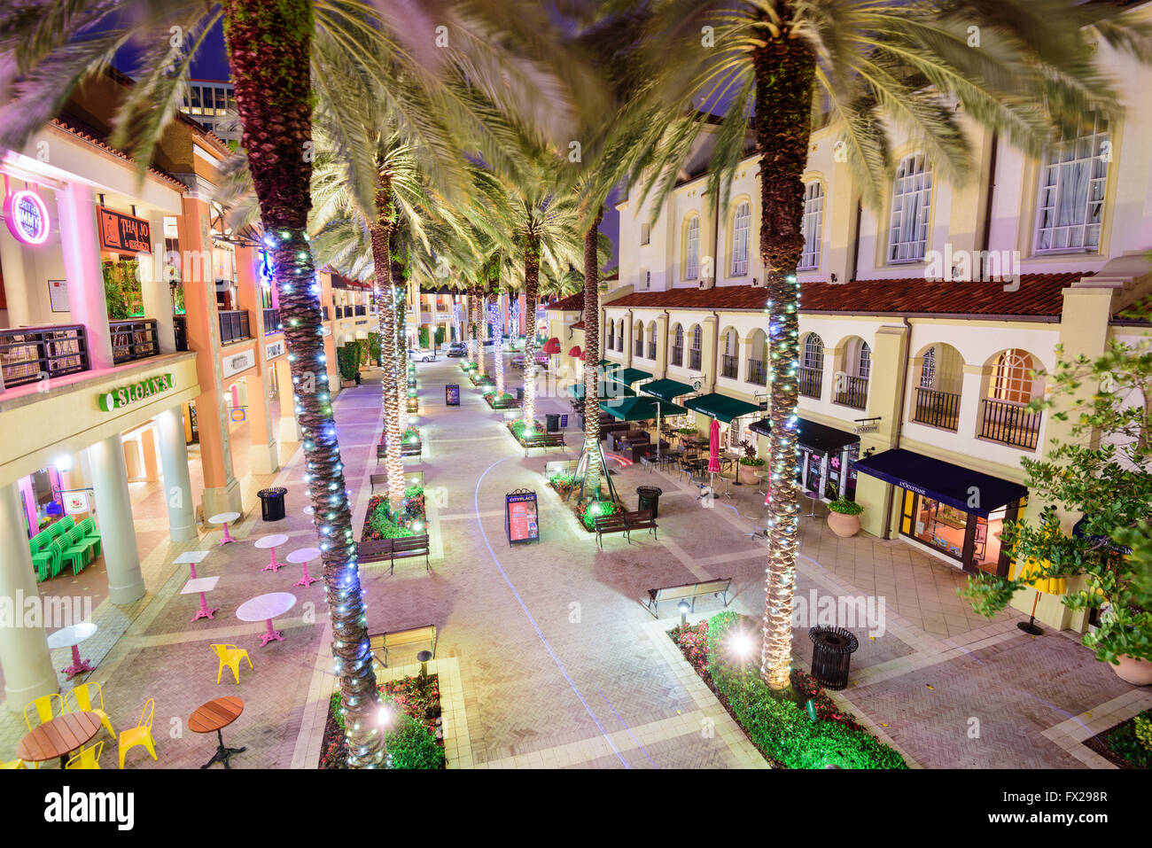 WEST PALM BEACH, FLORIDA - APRIL 3, 2016: Palm trees line CityPlace at night. The mixed-use  development was finished - Stock Image