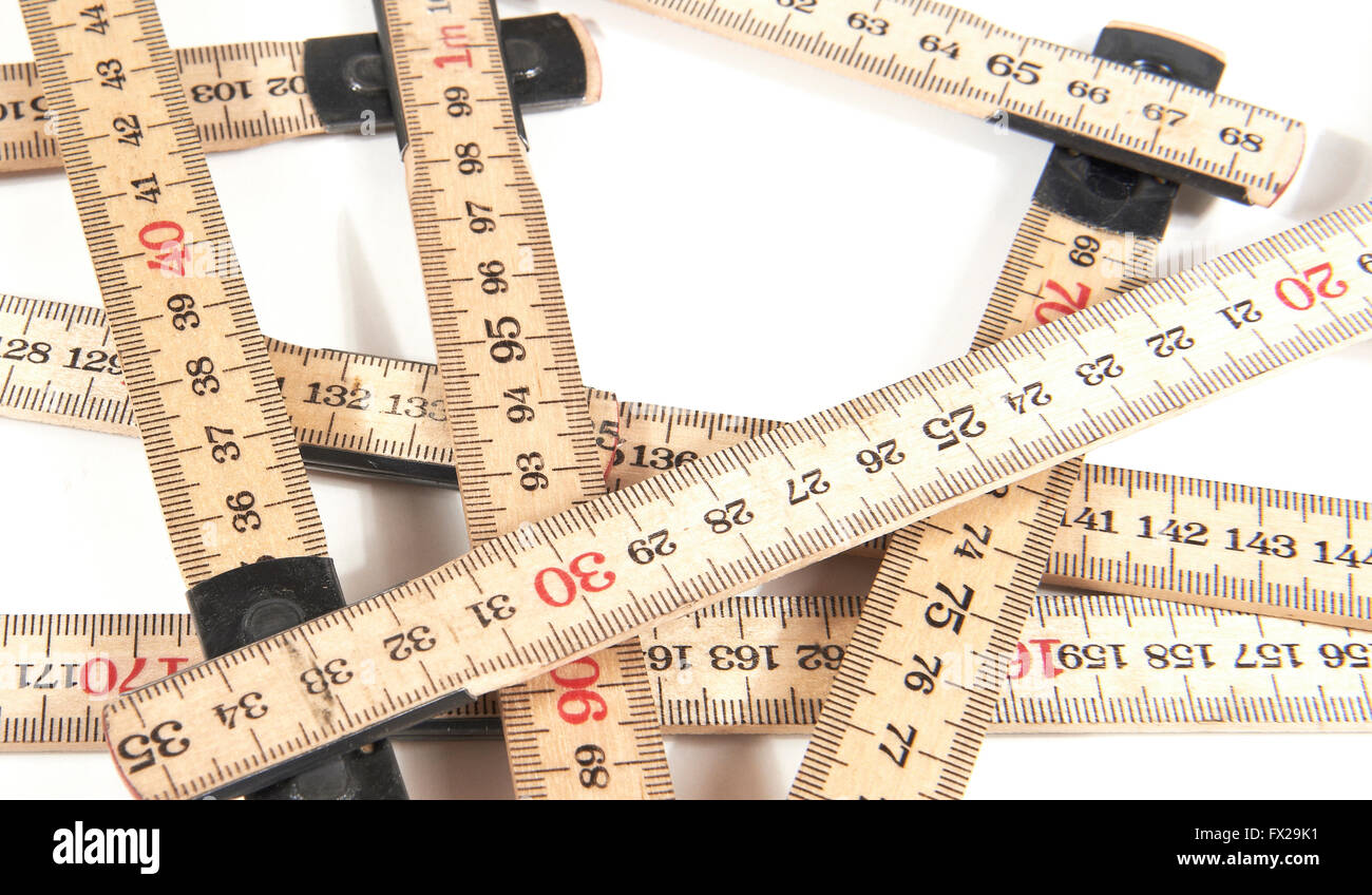 Closeup image of a Yardstick on a white background - Stock Image