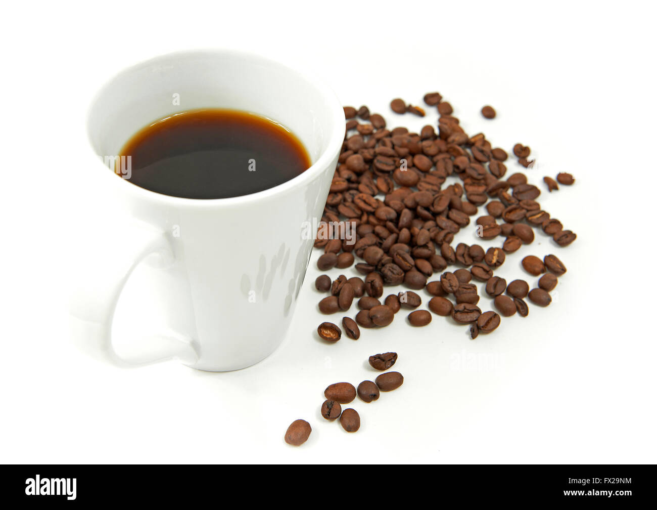 Brewed coffee and coffee beans isolated on white - Stock Image
