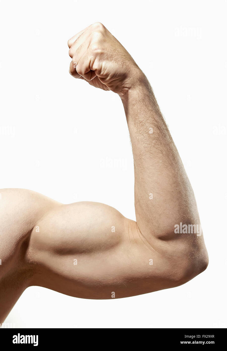 Closeup of a person flexing his biceps - Stock Image