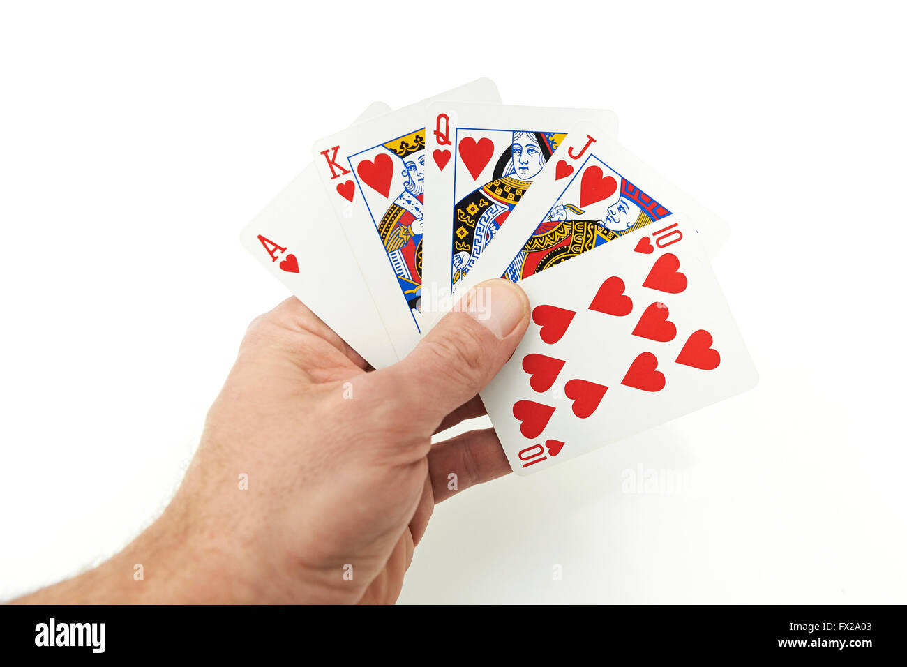 The hand of a Poker player holding royal flush - Stock Image