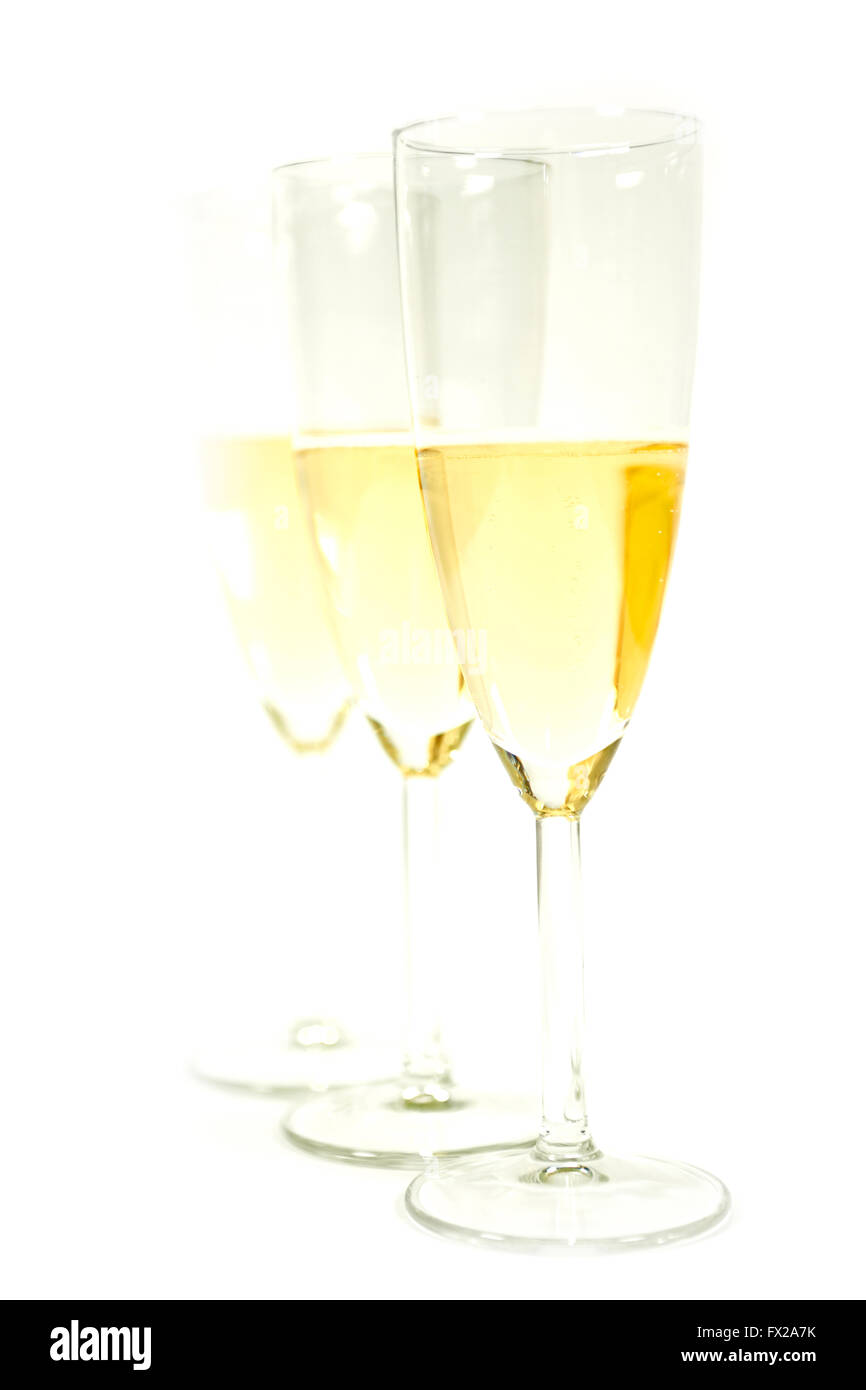 Three glasses of champaign shoot in high key with white background - Stock Image