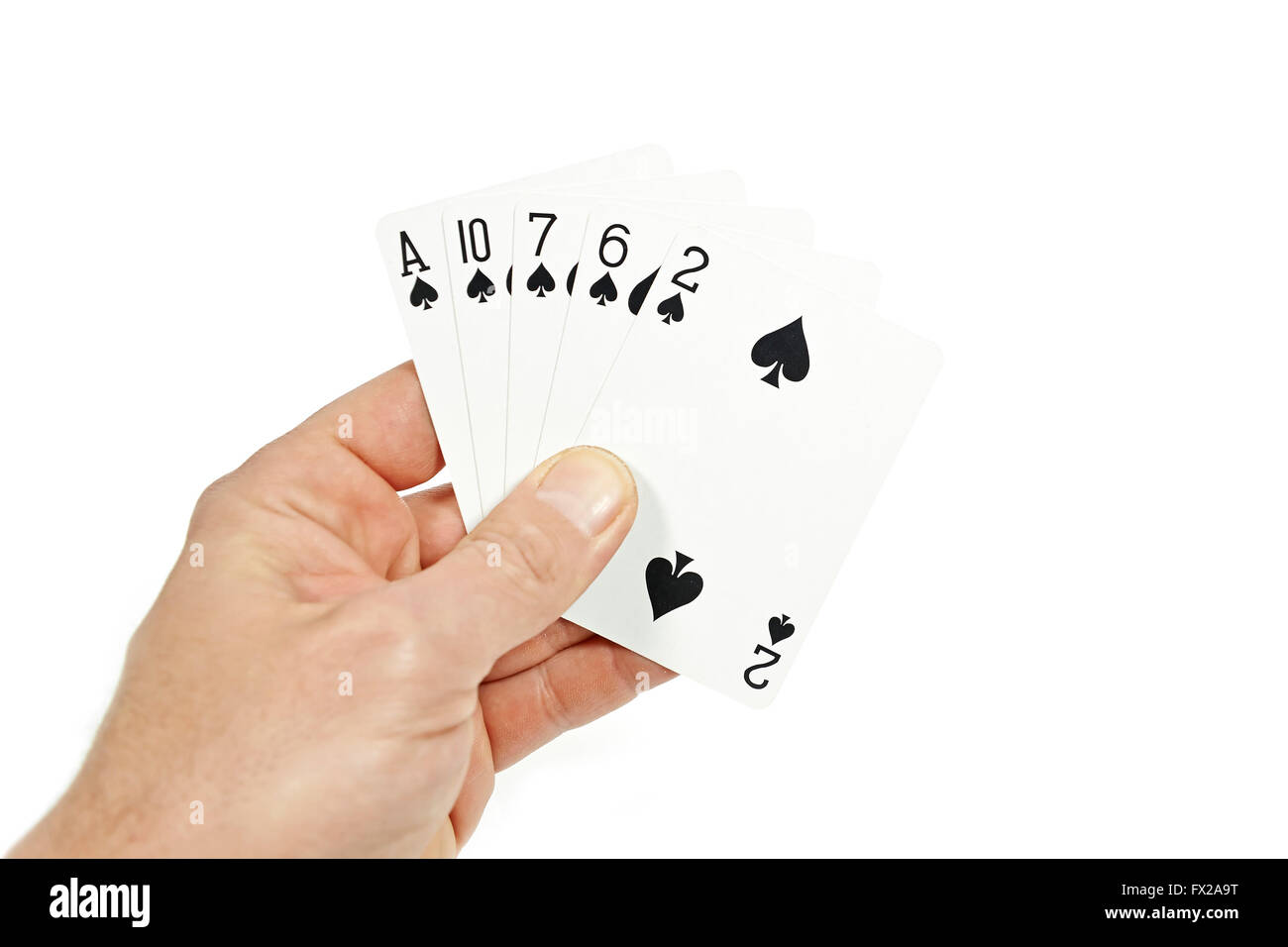 The hand of a Poker player holding flush - Stock Image