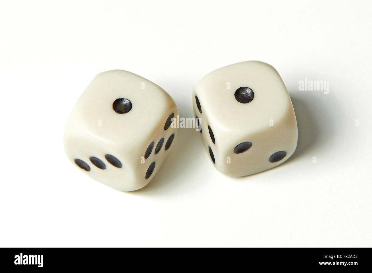 Pair of thrown dices showing two ones also called snake eyes - Stock Image