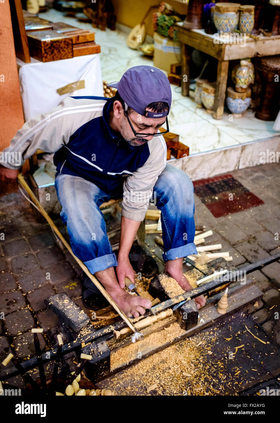 A craftsman woodworker at work out side his shop in the medina in Marrakech Morocco North Africa - Stock Image