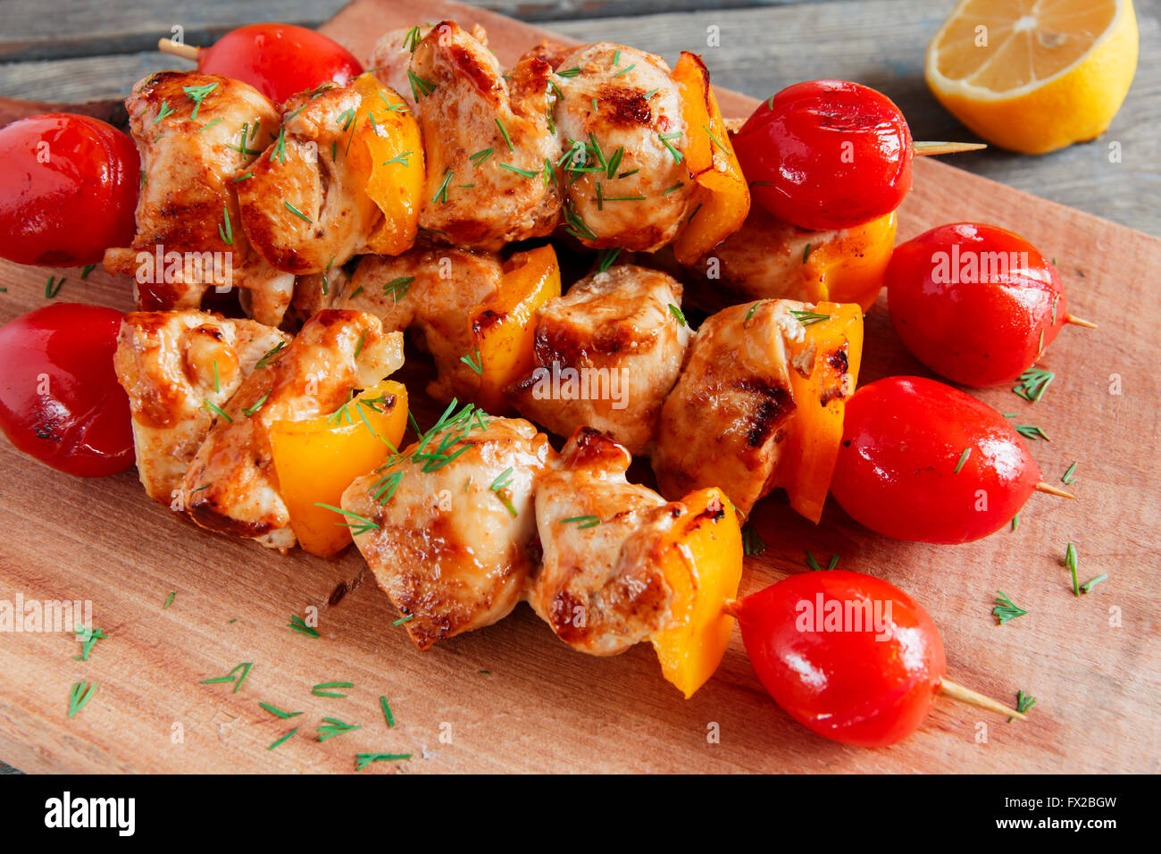 Chicken shish kebab with pepper tomato wooden skewer - Stock Image
