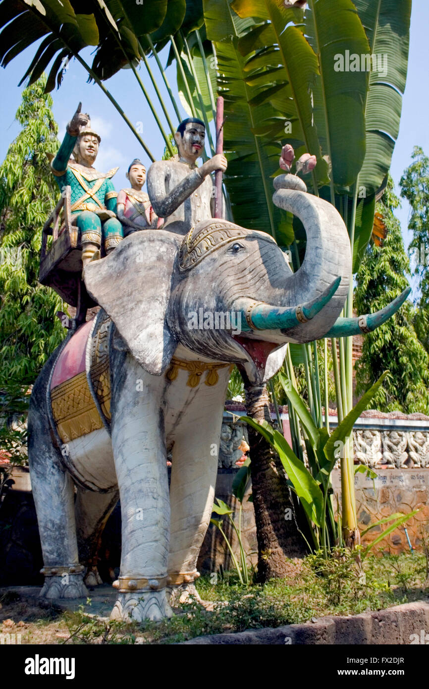 An elephant statue carrying people is displayed at a Buddhist Temple in Tboung Khmum Province, Cambodia. Stock Photo