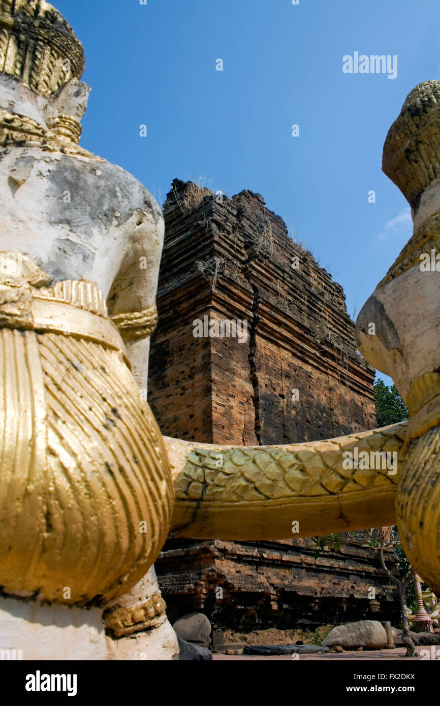 Gold Buddha statues are displayed near a stupa at a Buddhist Temple in Tboung Khmum Province, Cambodia. Stock Photo