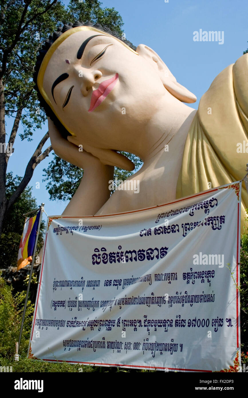 A large reclining Buddha is displayed at a Buddhist Temple in Tboung Khmum Province, Cambodia. Stock Photo