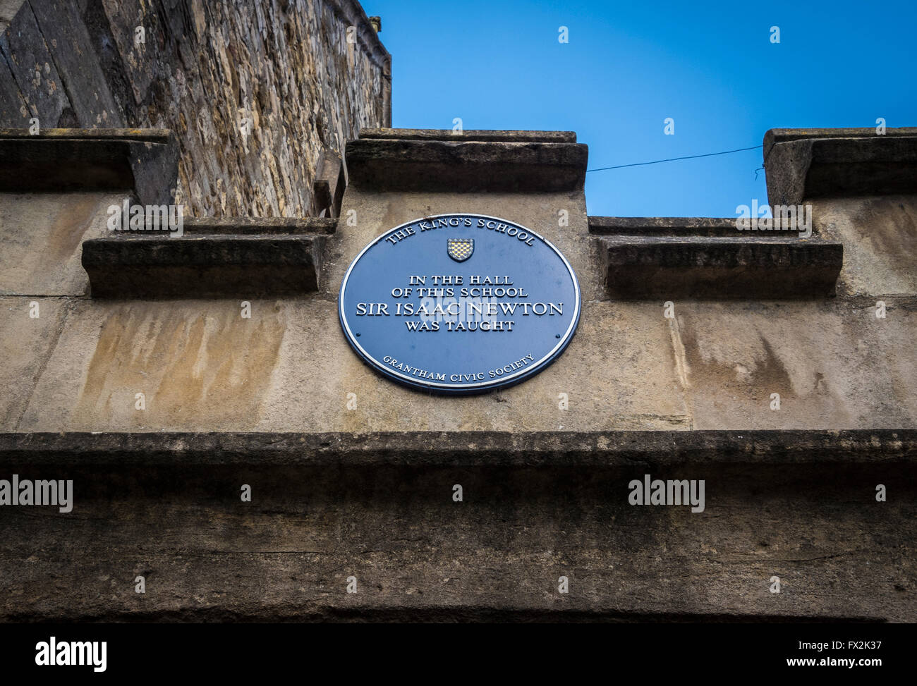 Plaque on The Original King's School building in Grantham, Lincolnshire, UK, where Sir Isaac Newton was taught. - Stock Image