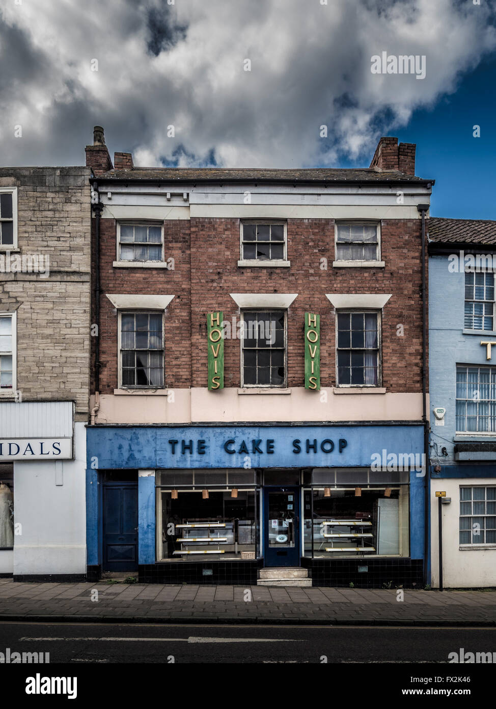 The Cake Shop with traditional Hovis signs, Watergate, Grantham, Lincolnshire, UK. - Stock Image