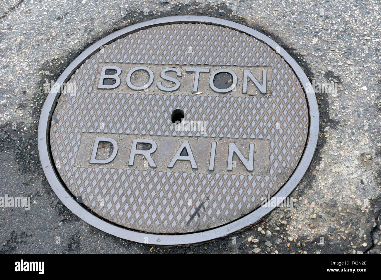 Manhole cover marked Boston Drain - Stock Image