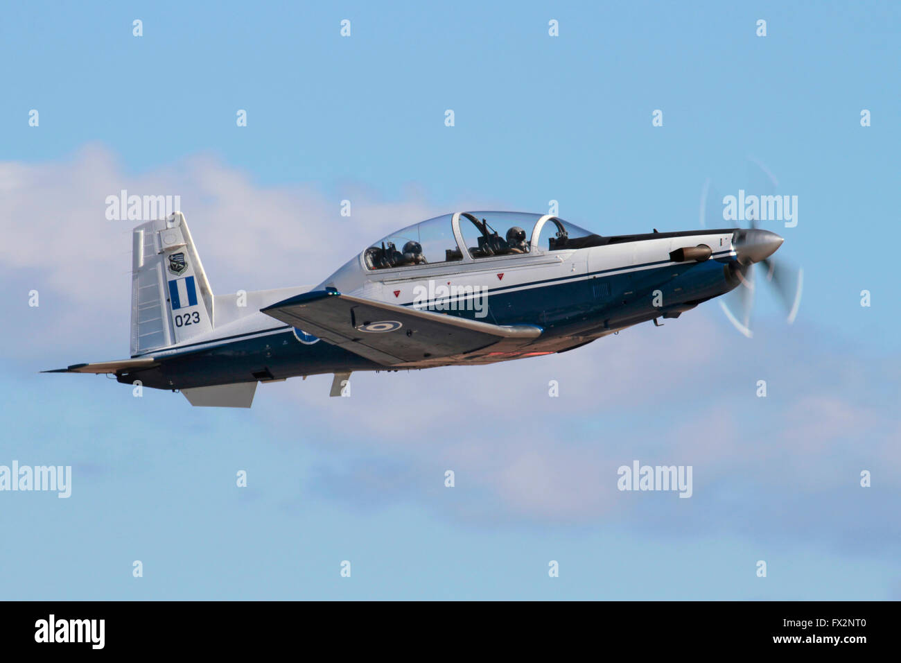 Military aviation training. Greek Air Force T-6A Texan II two-seat trainer aircraft flying in the sky - Stock Image