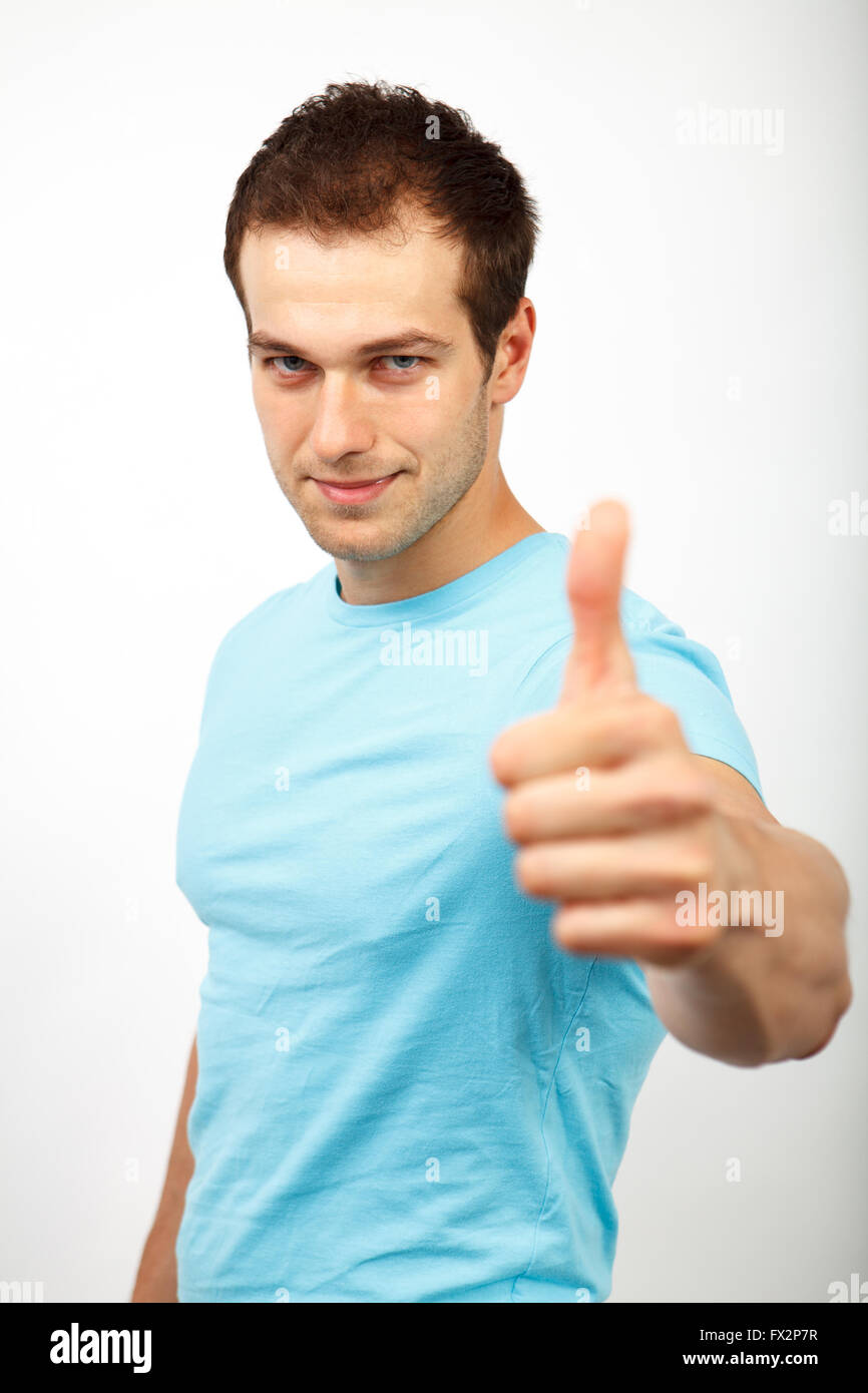 Young friendly man showing ok sign - Stock Image