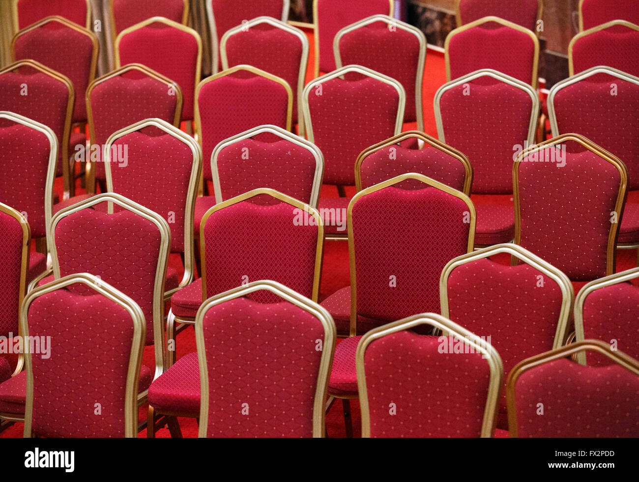 Rows of empty red seats in theater or cinema hall Stock Photo