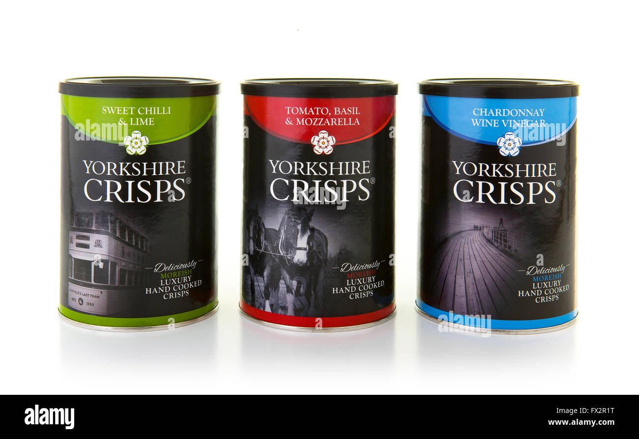 Three Tins of Luxury Hand Cooked Yorkshire Crisps on a white background - Stock Image