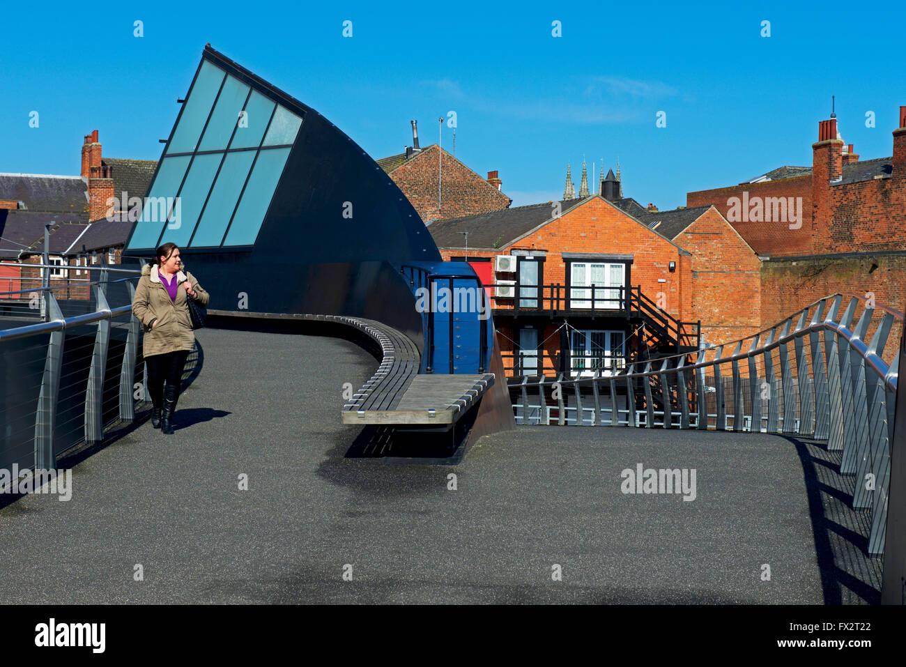Woman walking on Scale Lane Bridge, Hull, East Riding of Yorkshire, Humberside, England UK - Stock Image