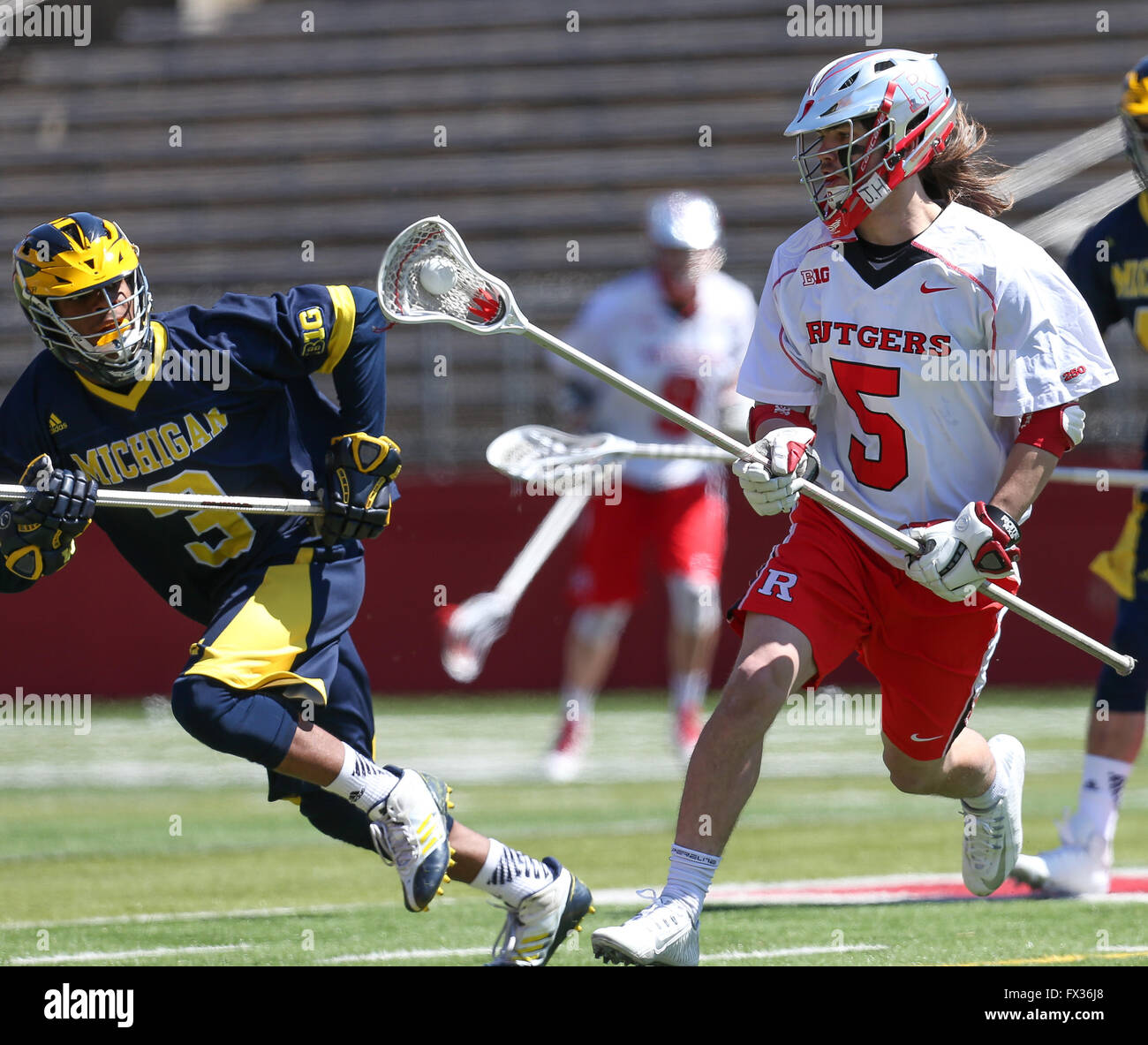 Piscataway, NJ, USA. 10th Apr, 2016. Rutgers Kyle Pless (5) brings the ball upfield during an NCAA Lacrosse game - Stock Image
