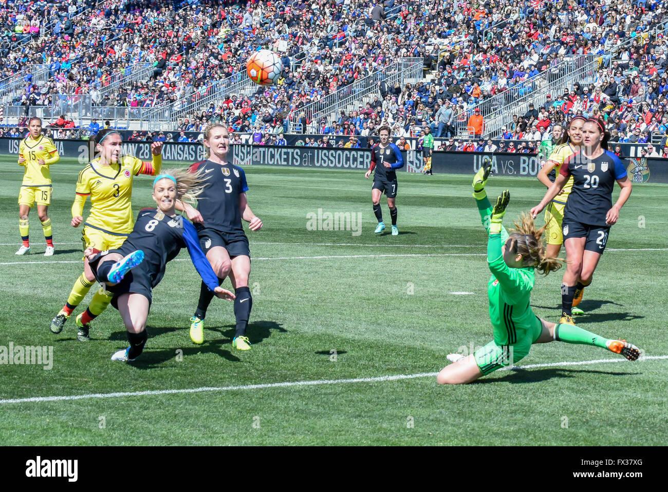 Julie Ertz / Julie Johnston womens soccer player scoring a goal in a World cup international friendly - US womens - Stock Image