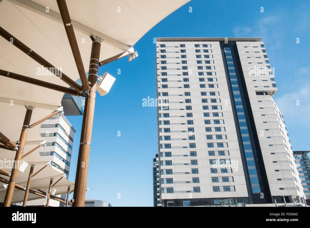 Diagonal Mar Hilton Hotel and canopy of Diagonal Mar Shopping Centre along Passeig del Taulat street,Port Forum,Barcelona. - Stock Image