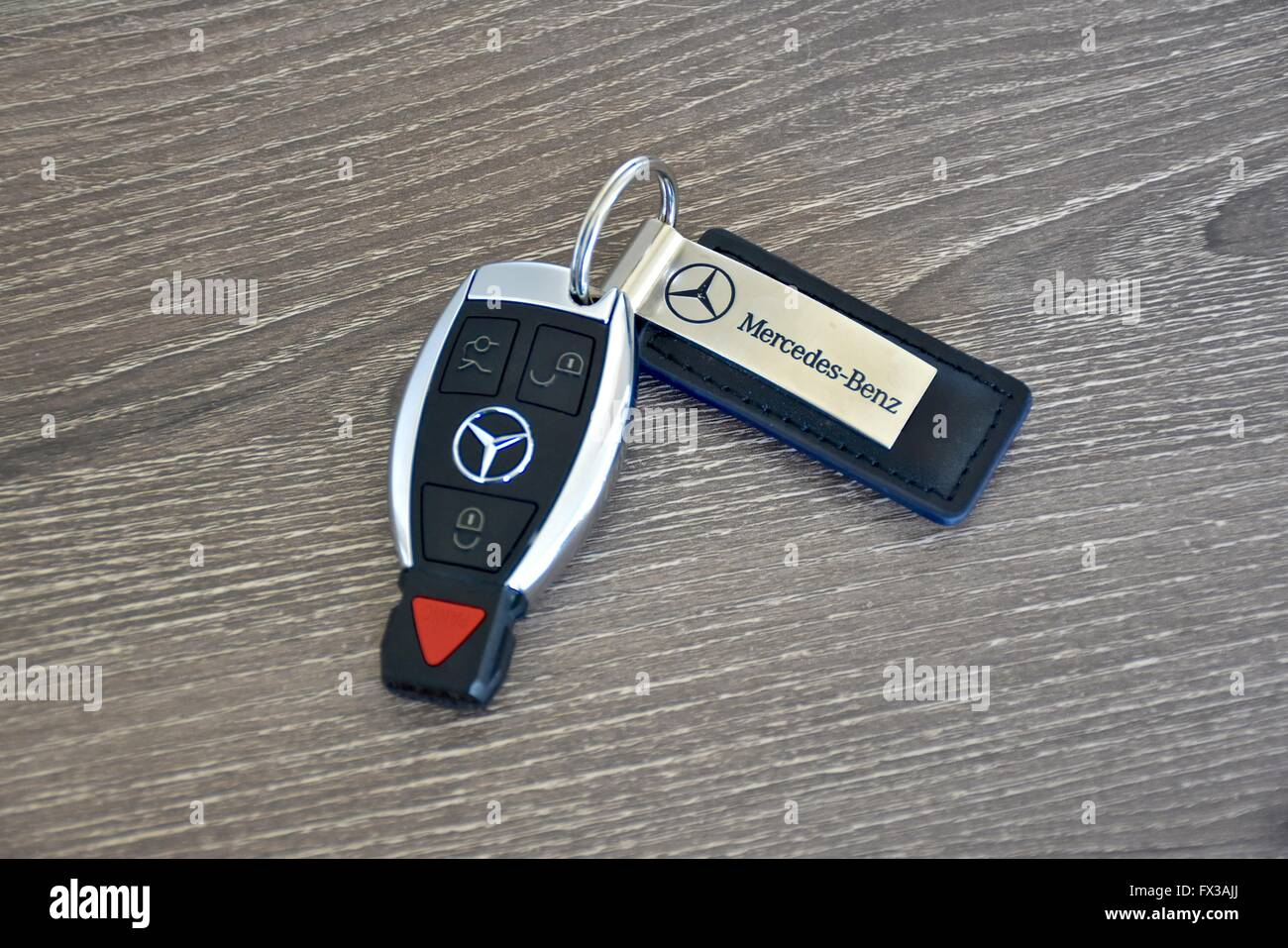 A Mercedes Benz Key Fob Laying On A Wood Surface