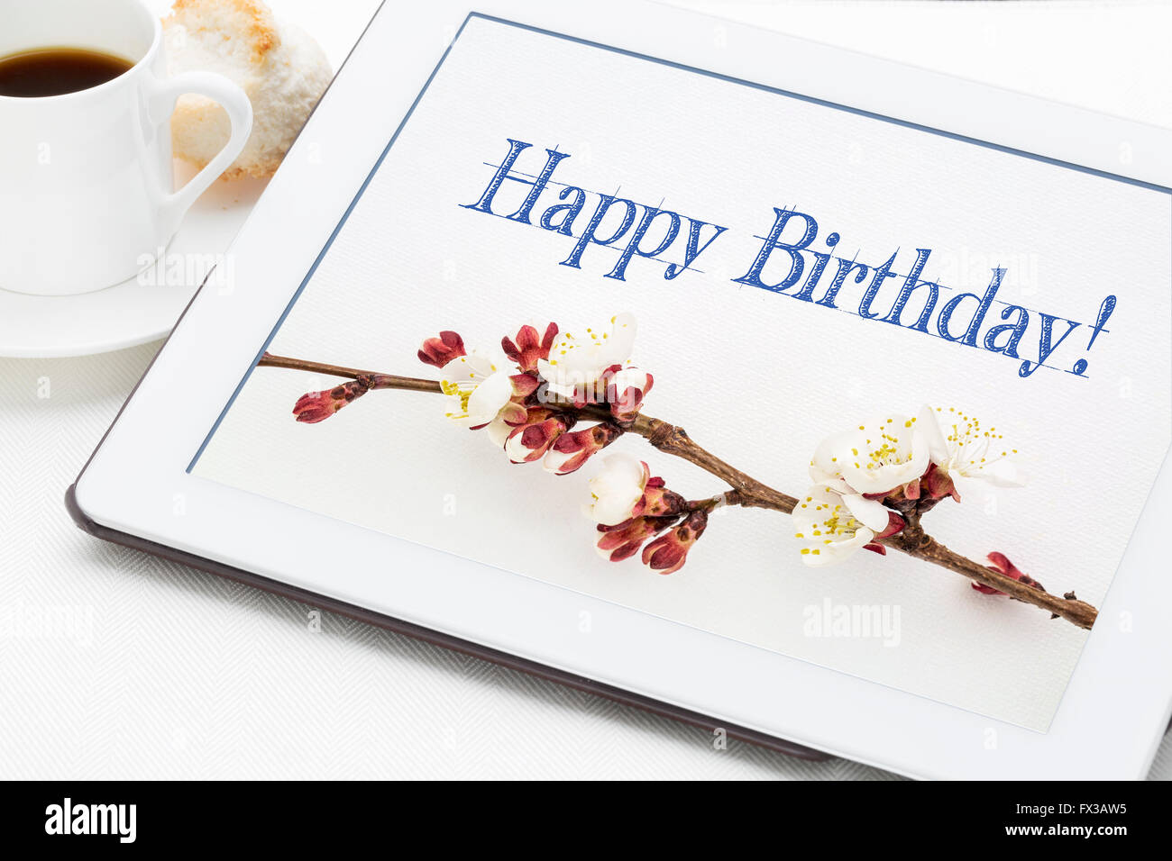 Happy birthday greeting card handwriting with apricot tree flowers happy birthday greeting card handwriting with apricot tree flowers on digital tablet with a cup of coffee m4hsunfo