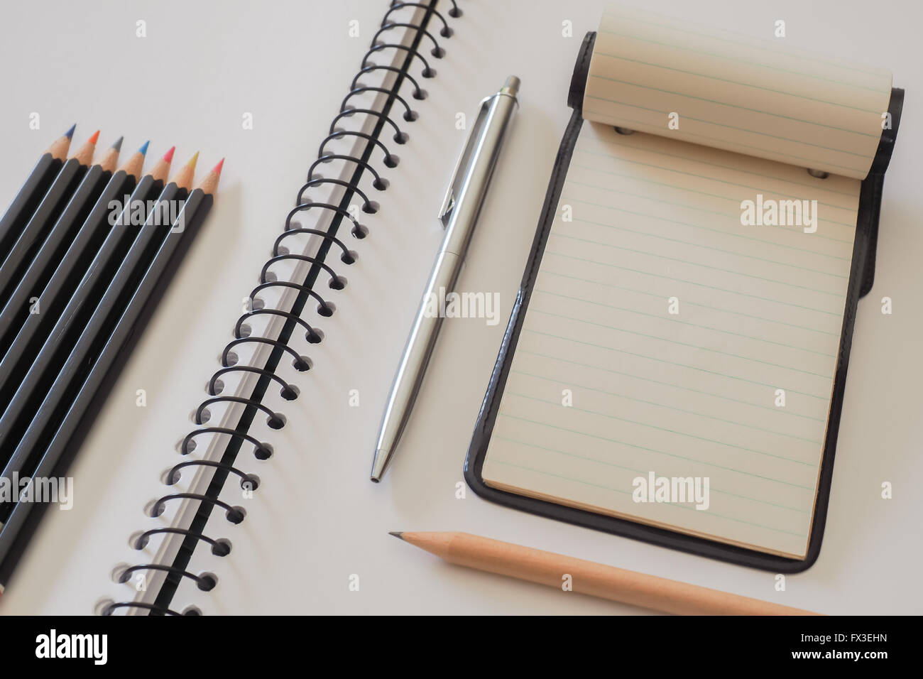 Note Pad with Colored Pencils - Stock Image