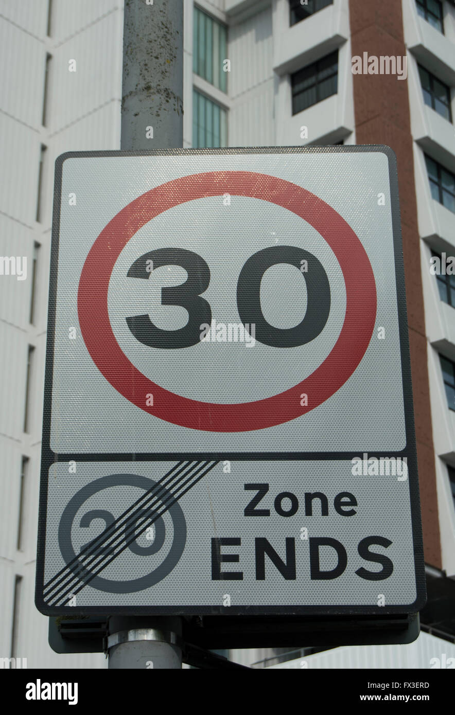 british road sign making the end of a 20mph speed limit zone and the start of a 30mph speed limit Stock Photo