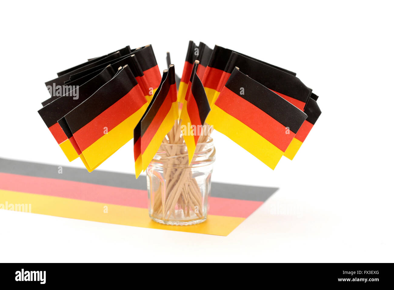 Little German flags on top of a German flag - Stock Image