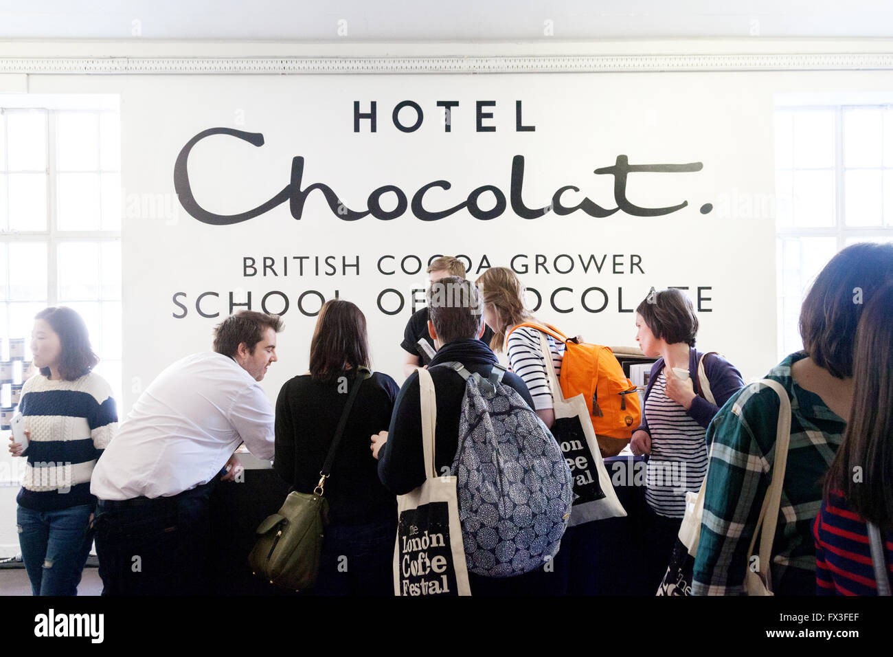 People At A Hotel Chocolat Stand British Cocoa Grower The