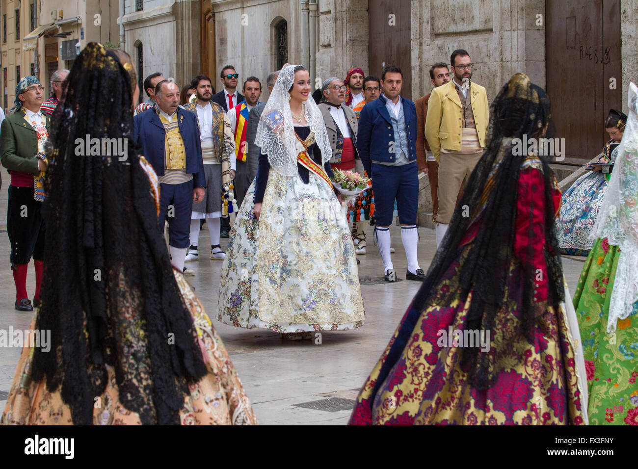 Flower offering procession honouring the holy Lady of Valencia during Fallas Fesgival, Valencia Spain - Stock Image