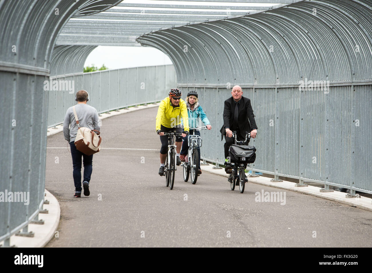 Cyclists commuting on cycle paths - Stock Image