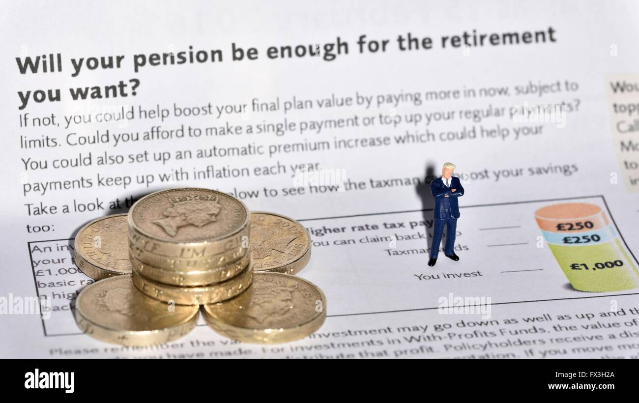 A miniature business man standing on a pension investment leaflet next to a stack of pound coins. - Stock Image