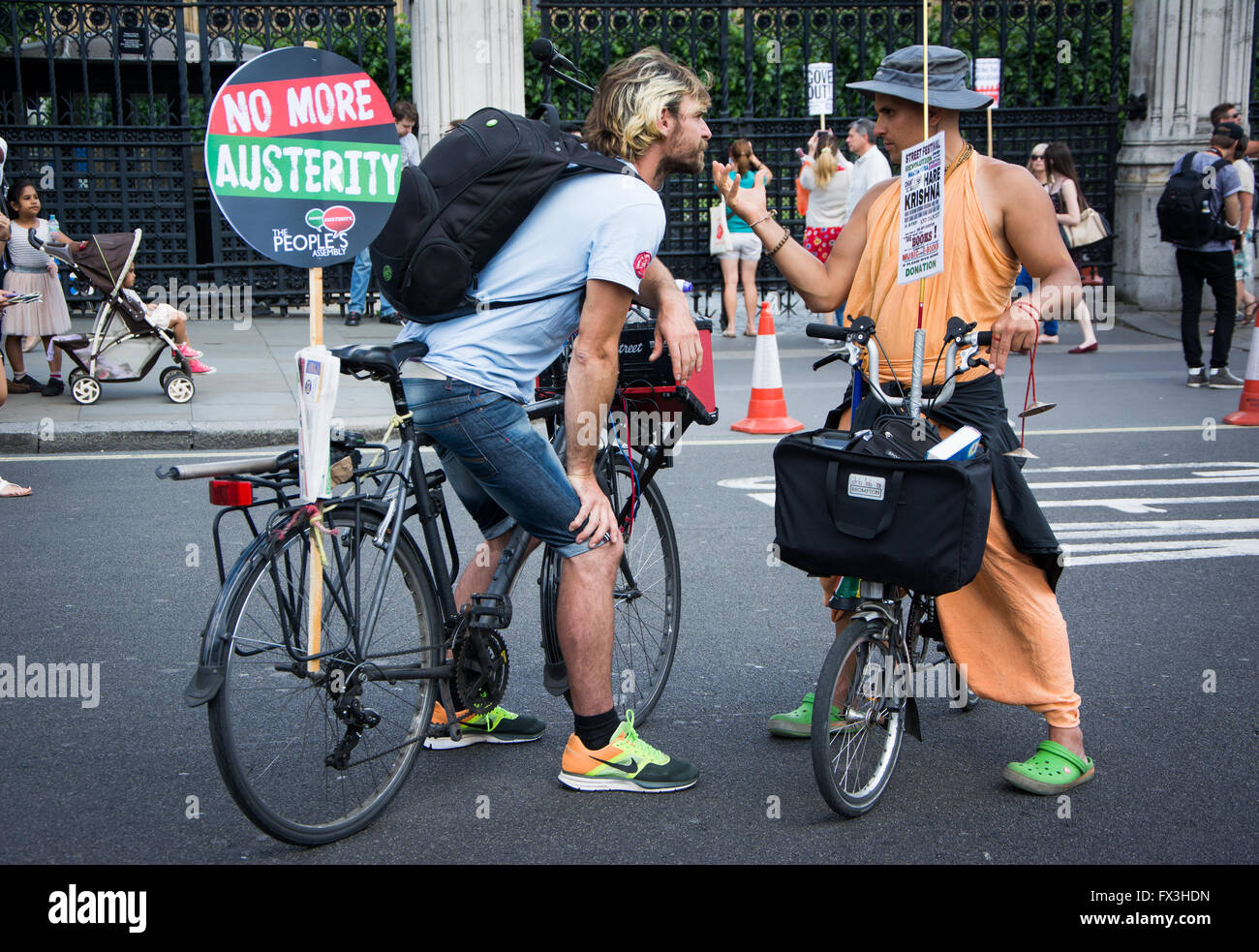 Street discussion at 'No More Austerity' protest march, London, June 21, 2014 - Stock Image