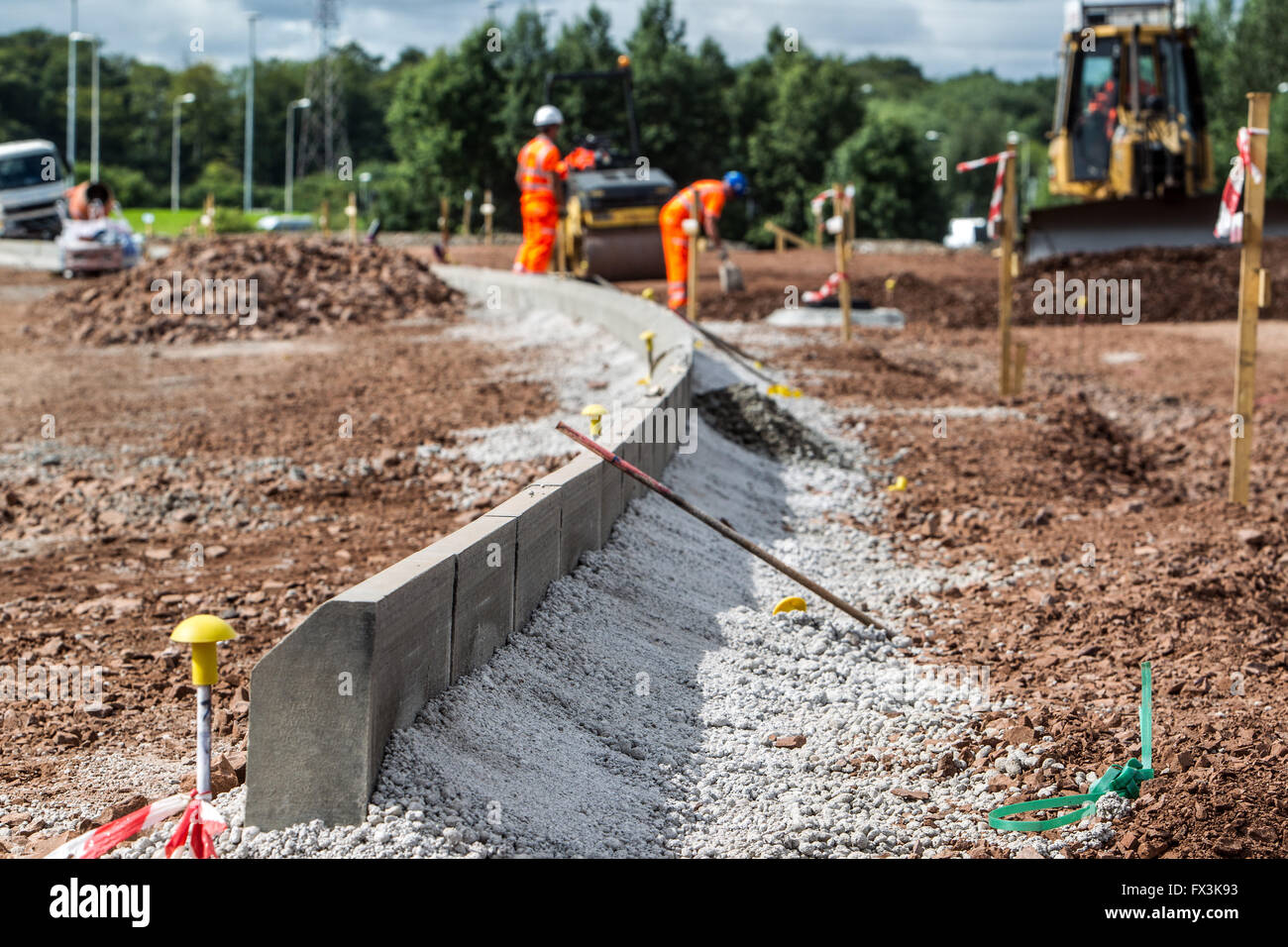 Surveyors working on new road construction - Stock Image