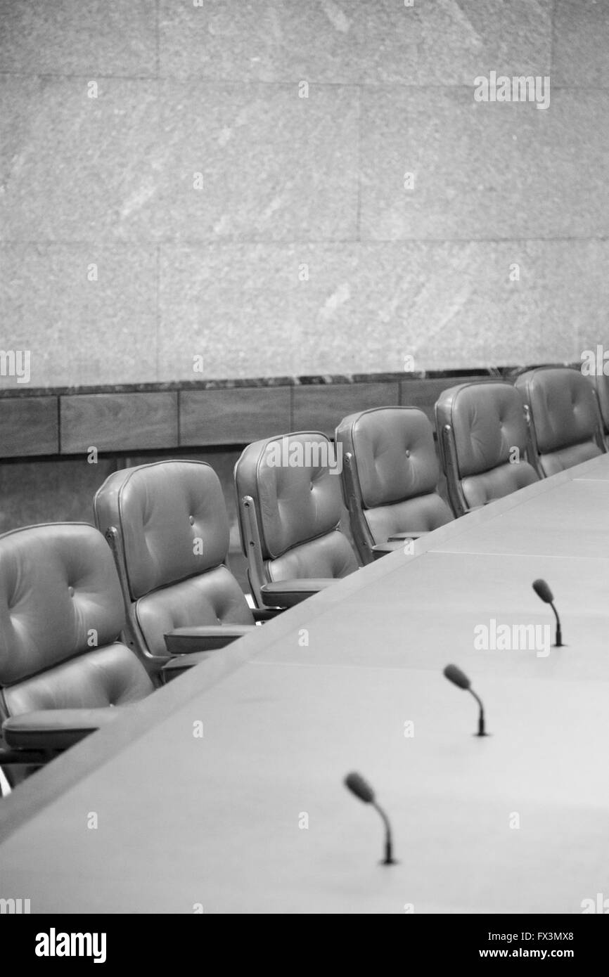 Empty seats at a board room table. - Stock Image