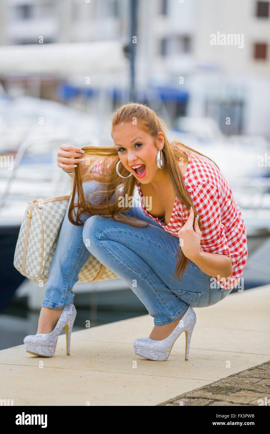 0778d82180e1 Highheels and denim pants pretty teenager outdoors squat squatting exposing  chest beautiful attractive stilettos stiletto legs smile smiling