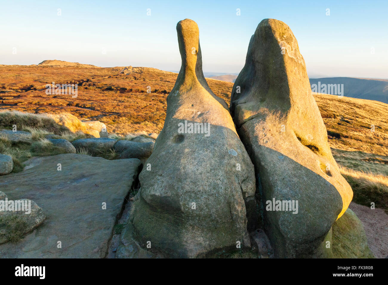 Unusual gritstone rock shapes in the late evening light of Autumn. Kinder Scout, Derbyshire, Peak District, England, - Stock Image
