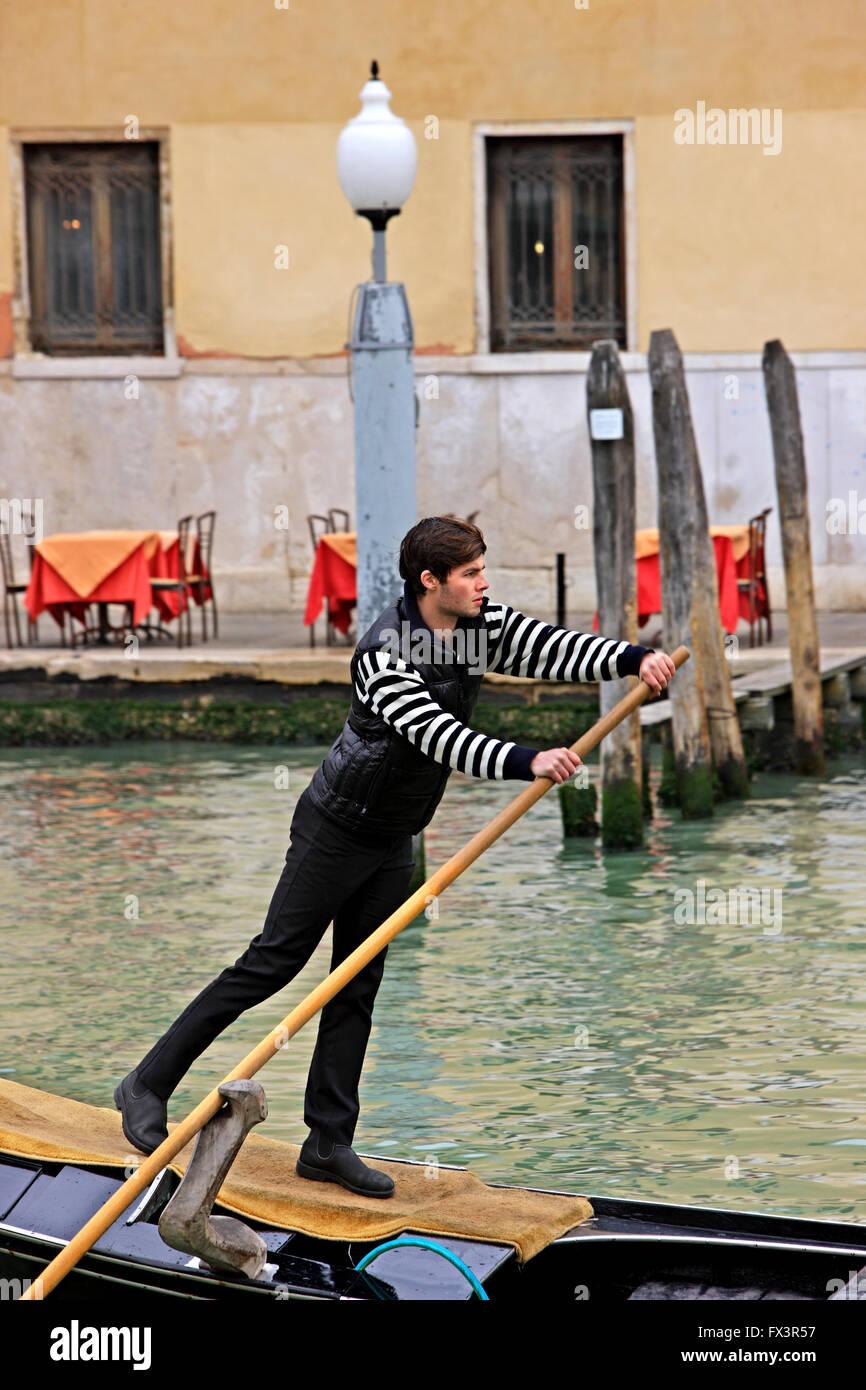 Gondolier in the Grand Canal, Venice, Veneto, Italy. - Stock Image